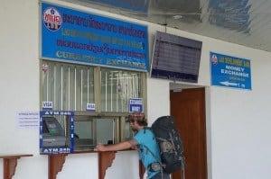 Jazza exchanging money at the border. Slow boat to Laos. Chiang Mai Chiang Rai Pai Chiang Khong Luang Prabang