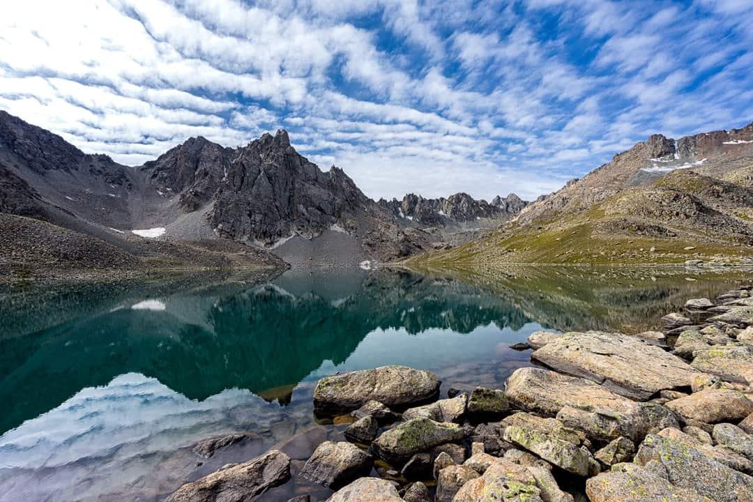 Photos Of Kyrgyzstan Reflective Lake Feature Jyrgalan Trek Kyrgyzstan